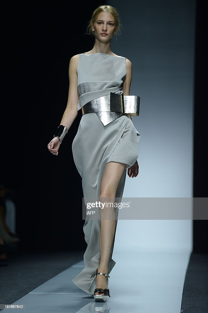 A model presents a creation for fashion house Gianfranco Ferre as part of the spring/summer 2014 ready-to-wear collections during the fashion week in Milan on September 23, 2013.