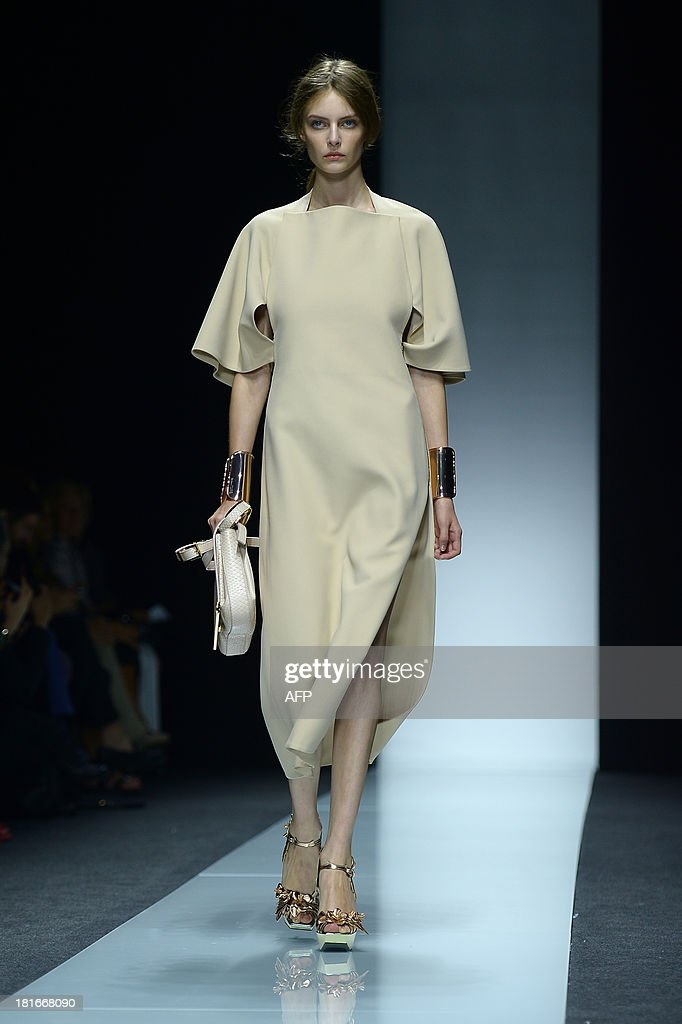 A model presents a creation for fashion house Gianfranco Ferre as part of the spring/summer 2014 ready-to-wear collections during the fashion week in Milan on September 23, 2013. AFP PHOTO / FILIPPO MONTEFORTE