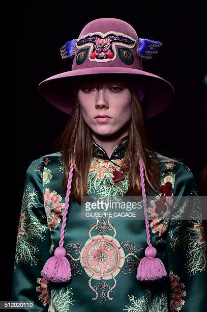 A model presents a creation for fashion house Gucci during the AutumnWinter 2016 / 2017 Milan Fashion Week on February 24 2016 / AFP / GIUSEPPE CACACE