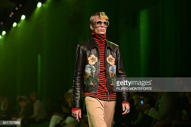 A model presents a creation for fashion house Gucci during the Men's Spring Summer 2017 fashion shows on June 20 2016 in Milan AFP PHOTO / FILIPPO...