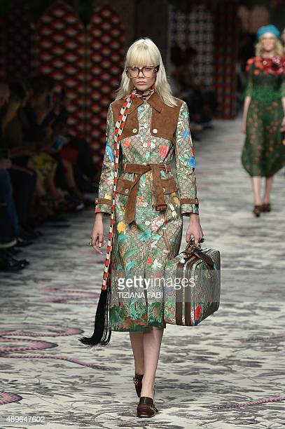 A model presents a creation for fashion house Gucci during the women Spring / Summer 2016 Milan's Fashion Week on September 23 2015 in Milan AFP...
