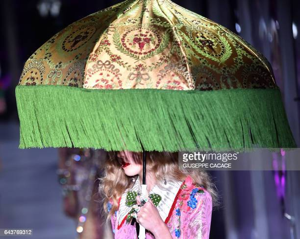 TOPSHOT A model presents a creation for fashion house Gucci during the Women's Fall/Winter 2017/2018 fashion week on February 22 2017 in Milan / AFP...