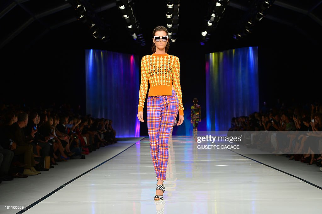 A model presents a creation for fashion house Just Cavalli as part of the spring/summer 2014 readytowear collections during the fashion week in Milan...