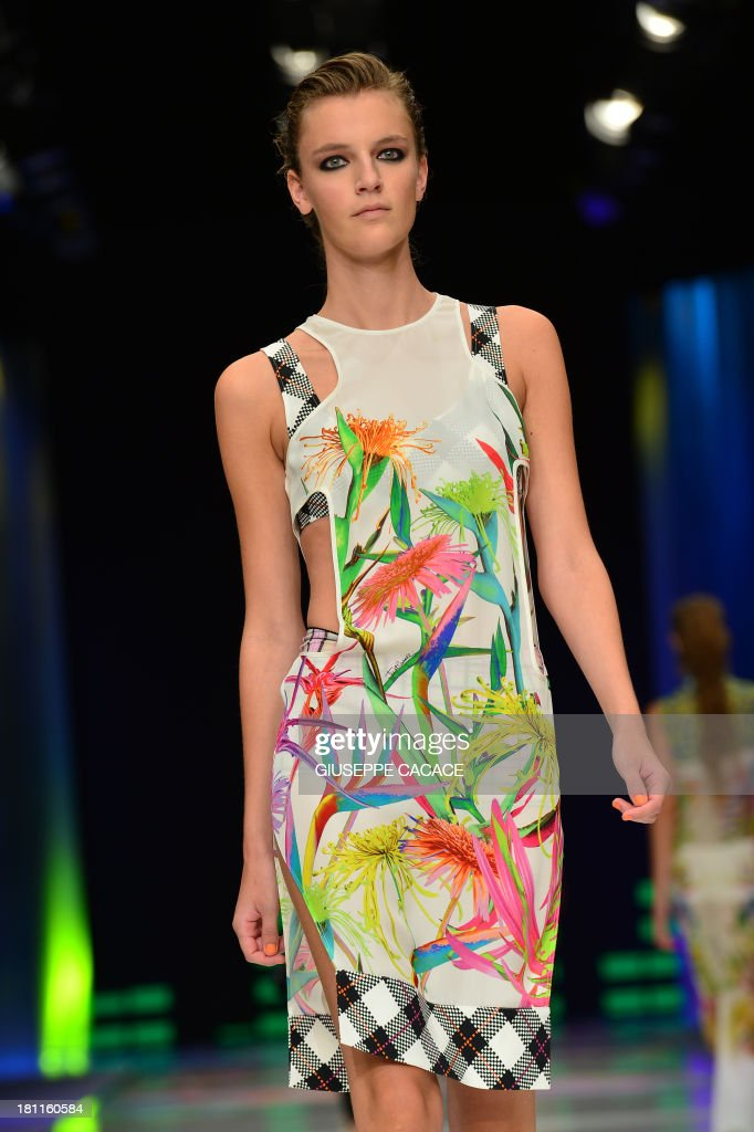 A model presents a creation for fashion house Just Cavalli as part of the spring/summer 2014 ready-to-wear collections during the fashion week in Milan on September 19, 2013.
