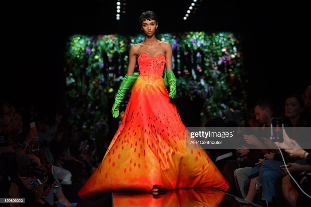 model-presents-a-creation-for-fashion-house-moschino-during-the-picture-id850806020