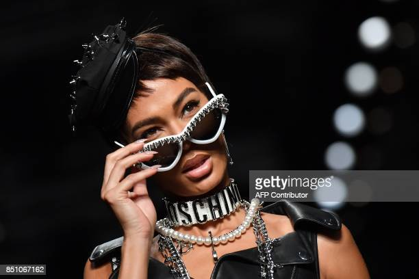 A model presents a creation for fashion house Moschino during the Women's Spring/Summer 2018 fashion shows in Milan on September 21 2017 / AFP PHOTO...