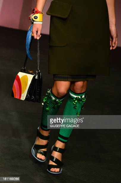 A model presents a creation for fashion house Prada as part of the spring/summer 2014 readytowear collections during the fashion week in Milan on...