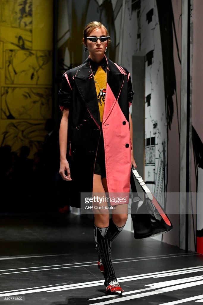 model-presents-a-creation-for-fashion-house-prada-during-the-womens-picture-id850774500