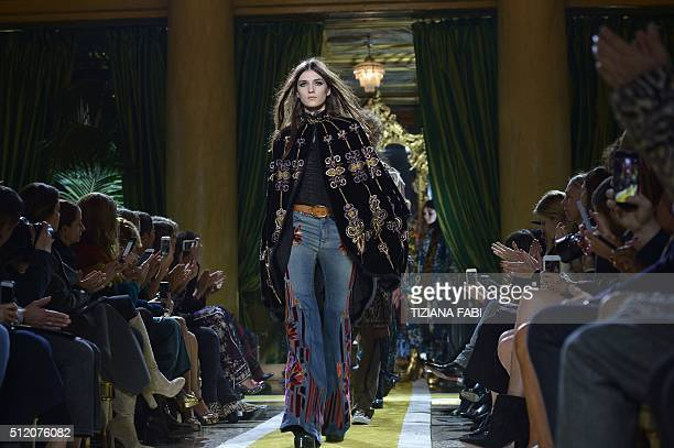 A model presents a creation for fashion house Roberto Cavalli during the Autumn / Winter 2016 Milan Fashion Week on February 24 2016 AFP PHOTO /...