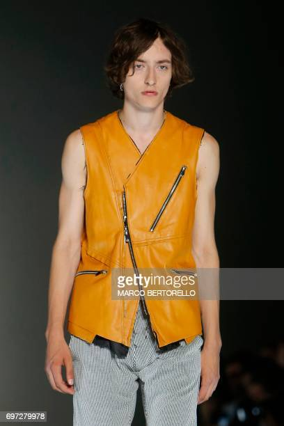 A model presents a creation for fashion house Sulvam during the Men's Spring/Summer 2018 fashion shows in Milan on June 18 2017 / AFP PHOTO / Marco...