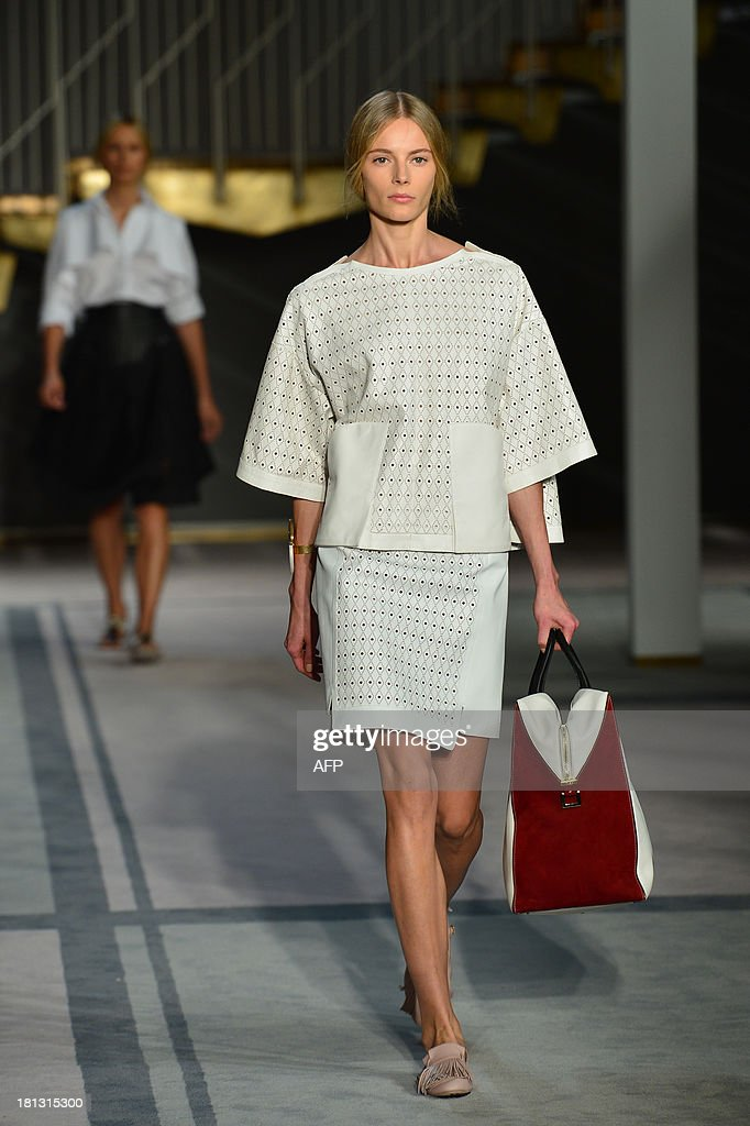 A model presents a creation for fashion house Tod's as part of the spring/summer 2014 ready-to-wear collections during the fashion week in Milan on September 20, 2013. AFP PHOTO / GIUSEPPE CACACE