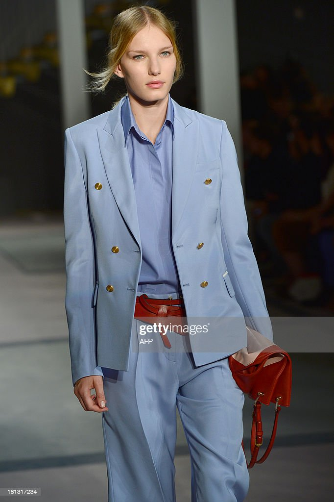 A model presents a creation for fashion house Tod's as part of the spring/summer 2014 ready-to-wear collections during the fashion week in Milan on September 20, 2013.