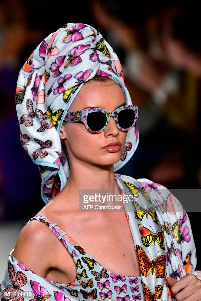 A model presents a creation for fashion house Versace during the Women's Spring/Summer 2018 fashion shows in Milan on September 22 2017 / AFP PHOTO /...