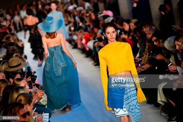 A model presents a creation for fashion house Vivetta during the Women's Spring/Summer 2018 fashion shows in Milan on September 21 2017 / AFP PHOTO /...