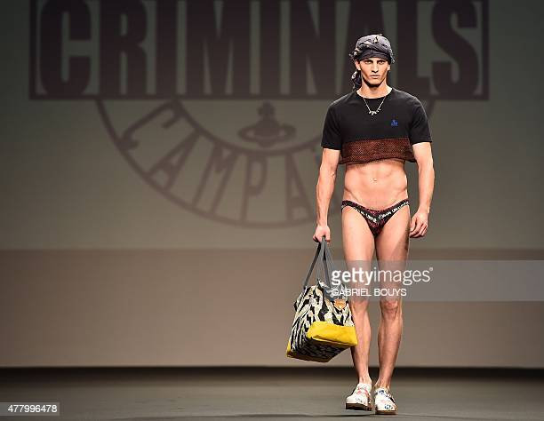 A model presents a creation for fashion house Vivienne Westwood at the Men SpringSummer 2016 Milan's Fashion Week on June 21 2015 AFP PHOTO / GABRIEL...