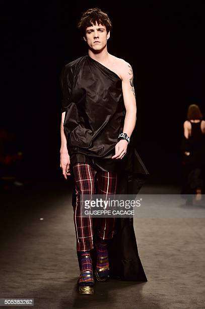 A model presents a creation for fashion house Vivienne Westwood during the Men Fall Winter 2016 / 2017 collection shows at the Milan's Fashion Week...
