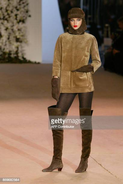A model presents a creation for French designer Yves Saint Laurent 22 January 2002 during the retrospective part of Saint Laurent's last ever show at...