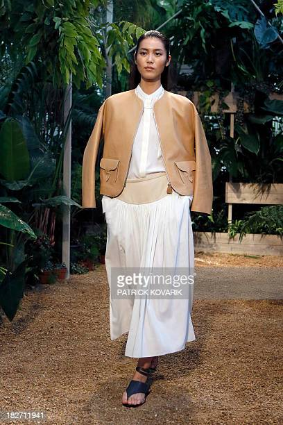 A model presents a creation for Hermes during the 2014 Spring/Summer readytowear collection fashion show on October 2 2013 in Paris AFP PHOTO /...