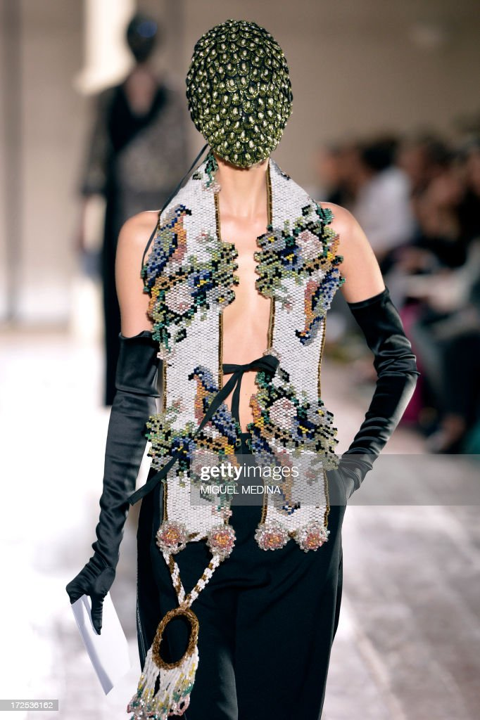 A model presents a creation for Maison Martin Margiela during the Haute Couture Fall-Winter 2013/2014 collection show, on July 3, 2013 in Paris.