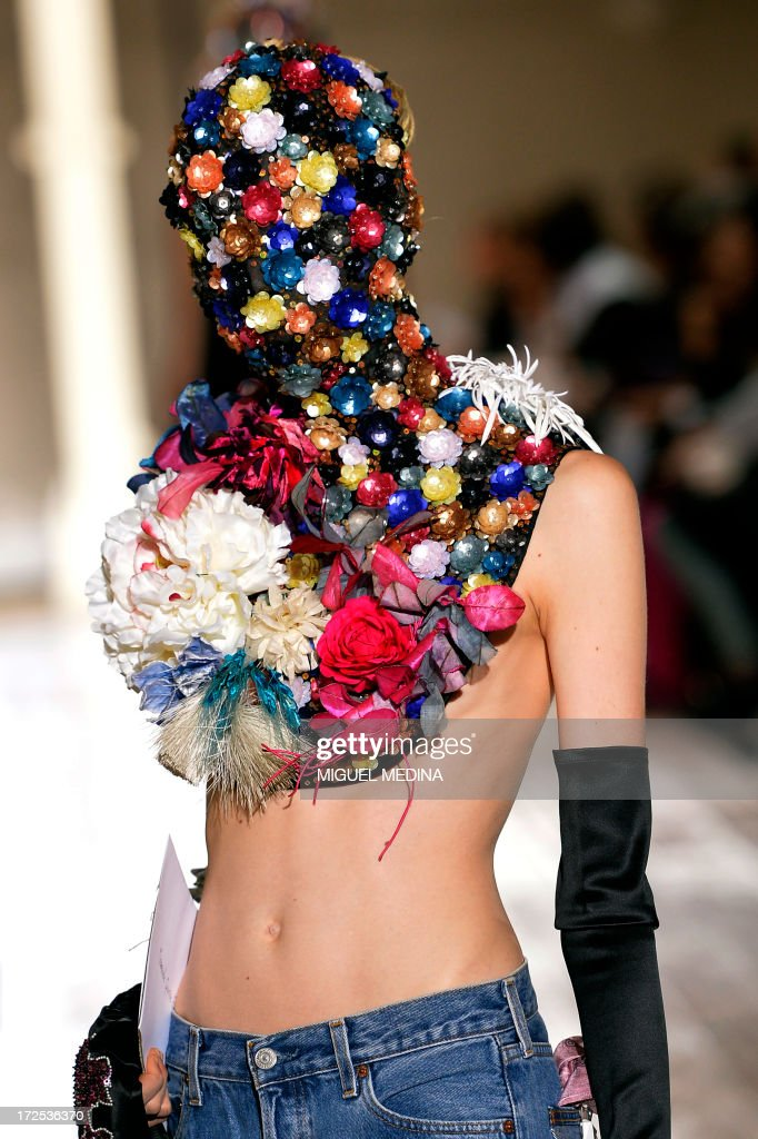 A model presents a creation for Maison Martin Margiela during the Haute Couture Fall-Winter 2013/2014 collection show, on July 3, 2013 in Paris. AFP PHOTO/MIGUEL MEDINA
