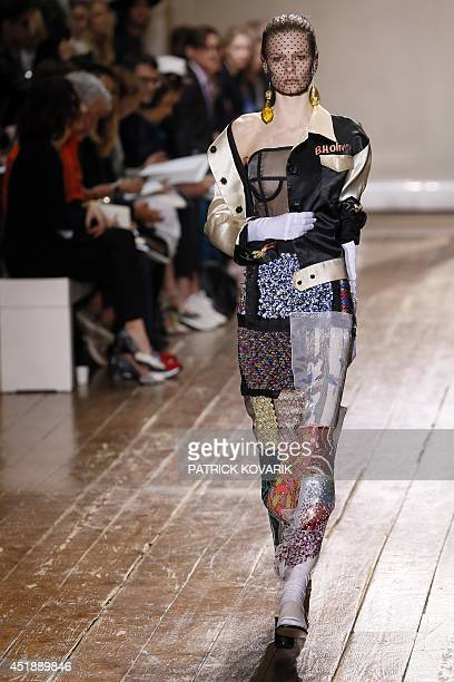 A model presents a creation for Maison Martin Margiela during the 2014/2015 Haute Couture FallWinter collection fashion show on July 9 2014 in Paris...