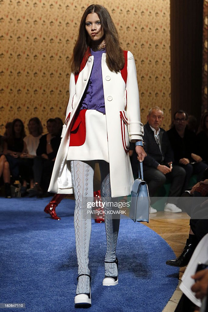 A model presents a creation for Miu Miu during the 2014 Spring/Summer ready-to-wear collection fashion show, on October 2, 2013 in Paris.