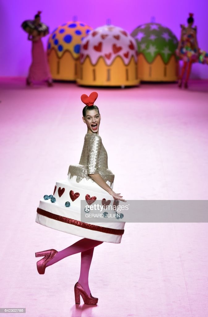 A model presents a creation from Agatha Ruiz de la Prada's Autumn/Winter 2017-2018 collection during the Mercedes-Benz Madrid Fashion Week in Madrid on February 17, 2017. / AFP / GERARD