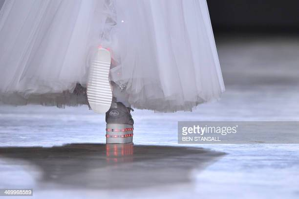 A model presents a creation from designer Ashish during the 2014 Autumn / Winter London Fashion Week in London on February 17 2014 AFP PHOTO / BEN...