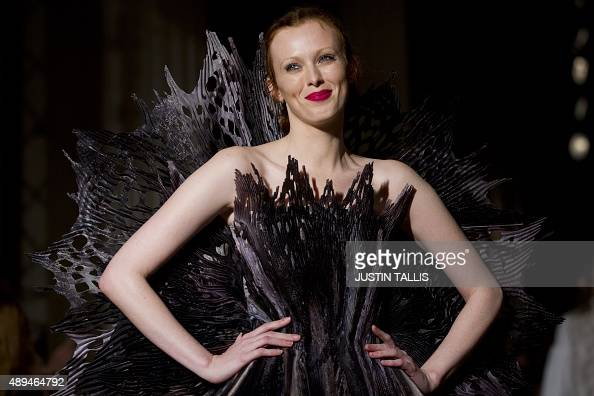 A model presents a creation from designer Giles during the 2016 Spring / Summer catwalk show during London Fashion Week in London on September 21...