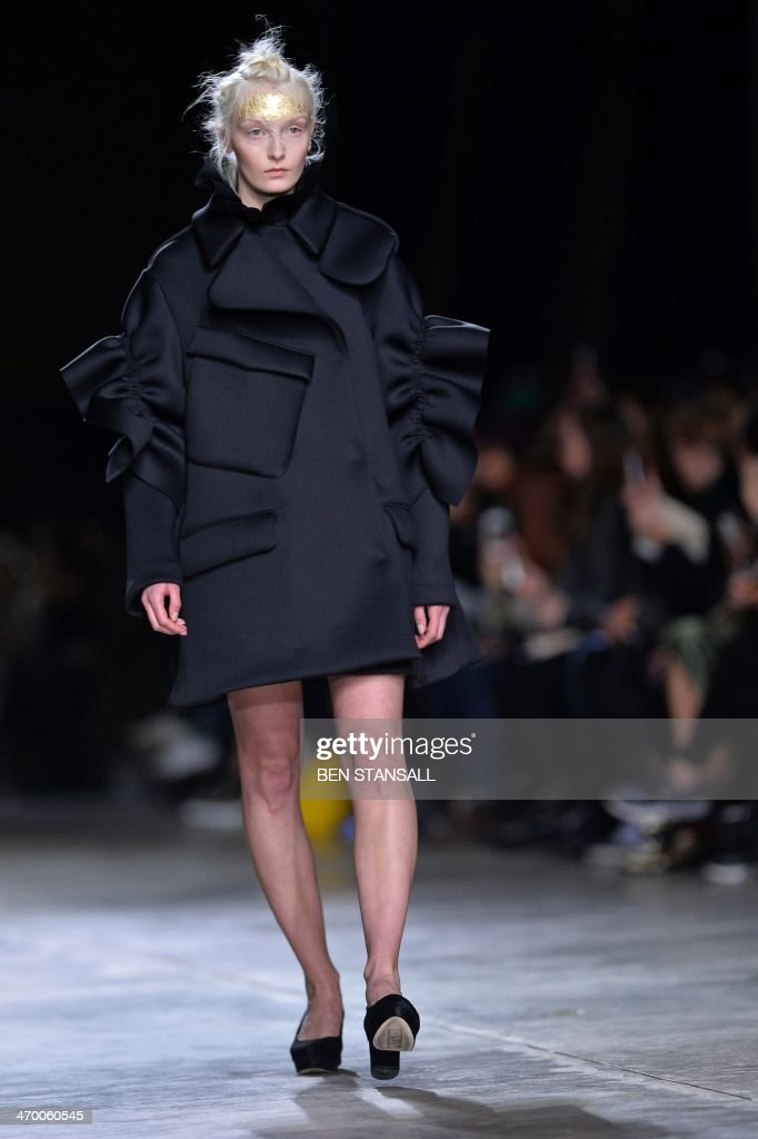 A model presents a creation from designer Simone Rocha during the 2014 Autumn / Winter London Fashion Week in London on February 18 2014 AFP PHOTO /...