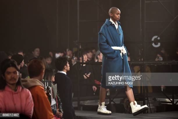 A model presents a creation from Name by Japanese designer Noriyuki Shimizu during the 2017 Autumn/Winter Collection show at Tokyo Fashion Week in...