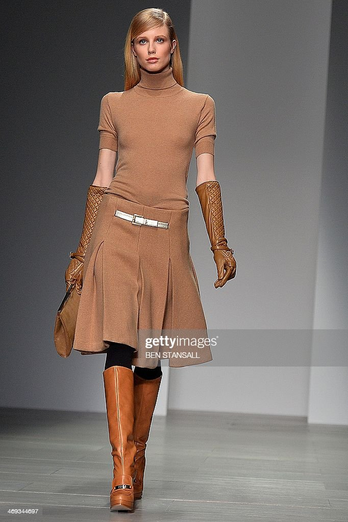 A model presents a creation from the DAKS collection during the 2014 Autumn / Winter London Fashion Week in London on February 14, 2014.