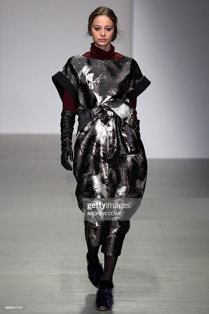 A model presents a creation from the Jean-Pierre Braganza collection during the 2014 Autumn/Winter London Fashion Week in London on February 14, 2014.