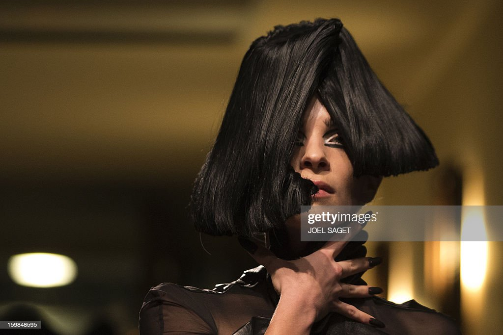 LACUT - A model presents a creation made with hair by Charlie Le Mindu, hairdresser and designer, during a 'Haute Coiffure' fashion show on January 21, 2013 in Paris. Charlie is a French designer that created an outfit and various hats and headpieces worn by Lady Gaga.