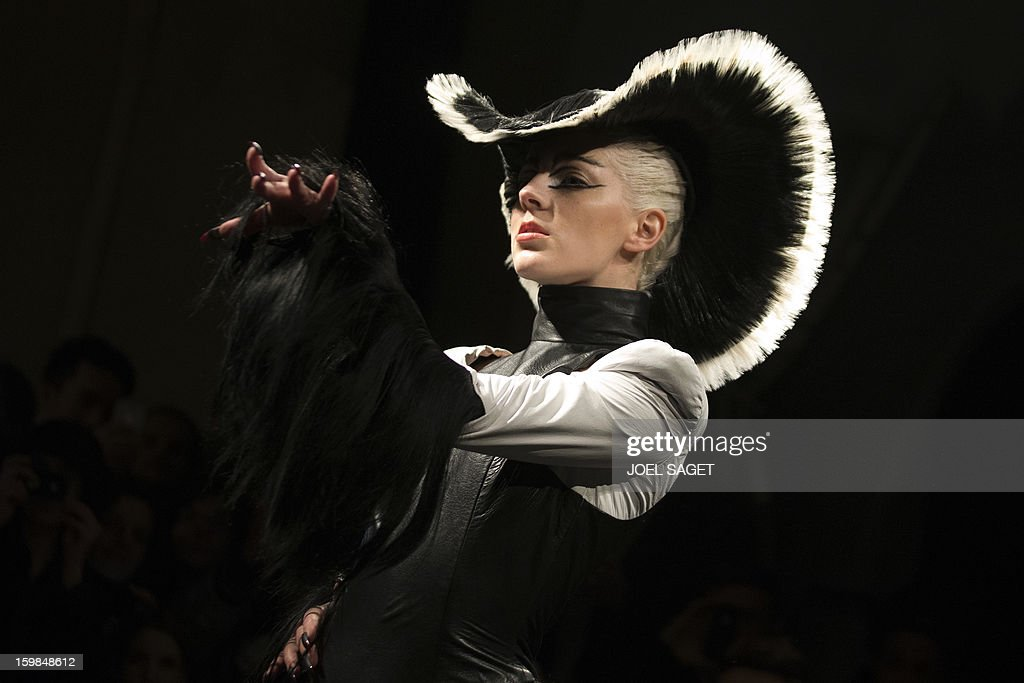 LACUT - A model presents a creation made with hair by Charlie Le Mindu, hairdresser and designer, during a 'Haute Coiffure' fashion show on January 21, 2013 in Paris. Charlie is a French designer that created an outfit and various hats and headpieces worn by Lady Gaga. AFP PHOTO /JOEL SAGET