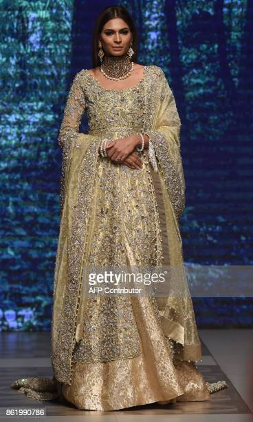 A model presents a creation of a Pakistani designer Tabya Khan during the final day of the Pakistan Fashion Design Council LOreal Paris Bridal Week...