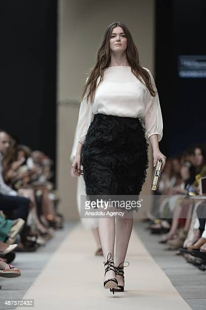 A model presents a creation of Adolfo Dominguez's plus sized fashion collection during Madrid Fashion Show at Cibeles Palace on September 9 2015 in...