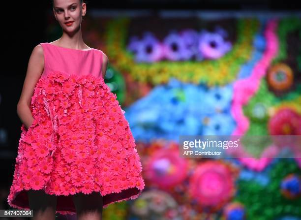 A model presents a creation of Agatha Ruiz de la Prada' Spring/Summer 2018 collection during the Madrid Fashion Week in Madrid on September 15 2017 /...