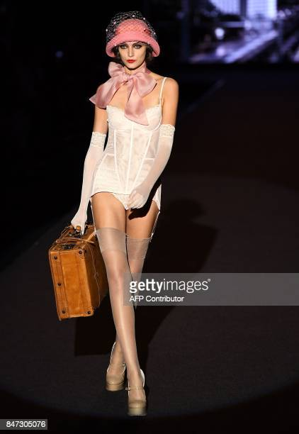 TOPSHOT A model presents a creation of Andres Sarda's Spring/Summer 2018 collection during the Madrid Fashion Week in Madrid on September 15 2017 /...