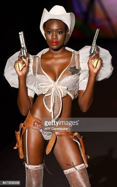 A model presents a creation of Andres Sarda's Spring/Summer 2018 collection during the Madrid Fashion Week in Madrid on September 15 2017 / AFP PHOTO...