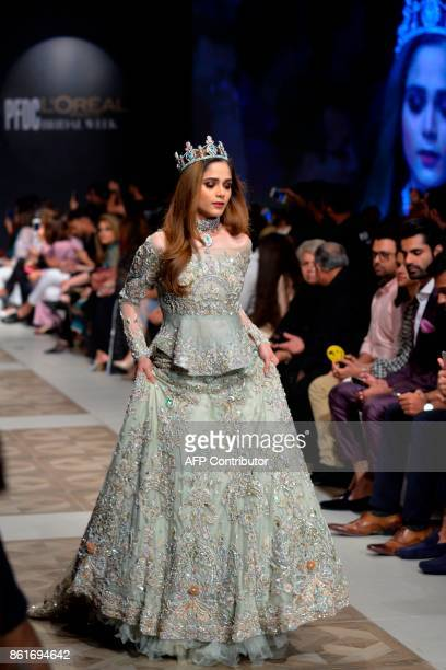 A model presents a creation of designer Ahmad Sultan during the second day of the Pakistan Fashion Design Council LOreal Paris Bridal Week in Lahore...