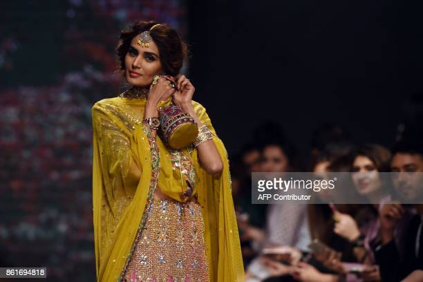 A model presents a creation of designer Faiza Saqlain during the second day of the Pakistan Fashion Design Council LOreal Paris Bridal Week in Lahore...