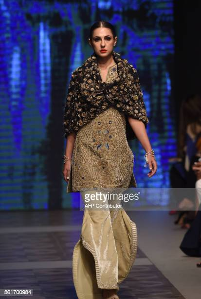 A model presents a creation of designer Mahgul during the second day of the Pakistan Fashion Design Council LOreal Paris Bridal Week in Lahore on...