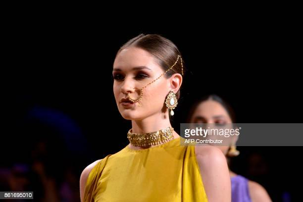 A model presents a creation of designer Sana Safinaz during the second day of the Pakistan Fashion Design Council LOreal Paris Bridal Week in Lahore...