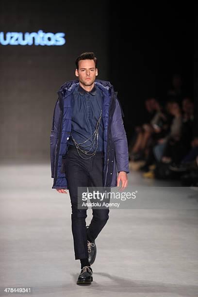 A model presents a creation of designer Serdar Uzuntas's collection for 2014 Autumn / Winter during the MercedesBenz Fashion Week at Tophane Antrepo...
