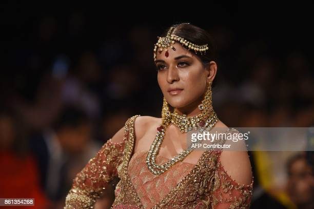 A model presents a creation of designer Shiza Hassan during the first day of the Pakistan Fashion Design Council LOreal Paris Bridal Week in Lahore...