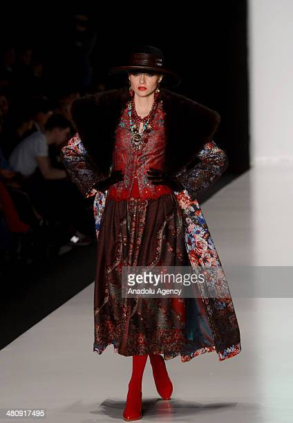 A model presents a creation of designer Slava Zaitsen's collection for 2014 Autumn / Winter during the MercedesBenz Fashion Week Russia at Manezh...