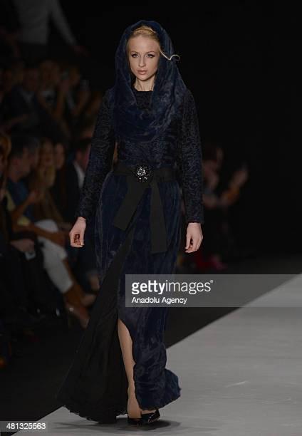 A model presents a creation of Igor Gulyaev's 'MercedesBenz Presents' collection for 2014/2014 AutumnWinter during the MercedesBenz Fashion Week...