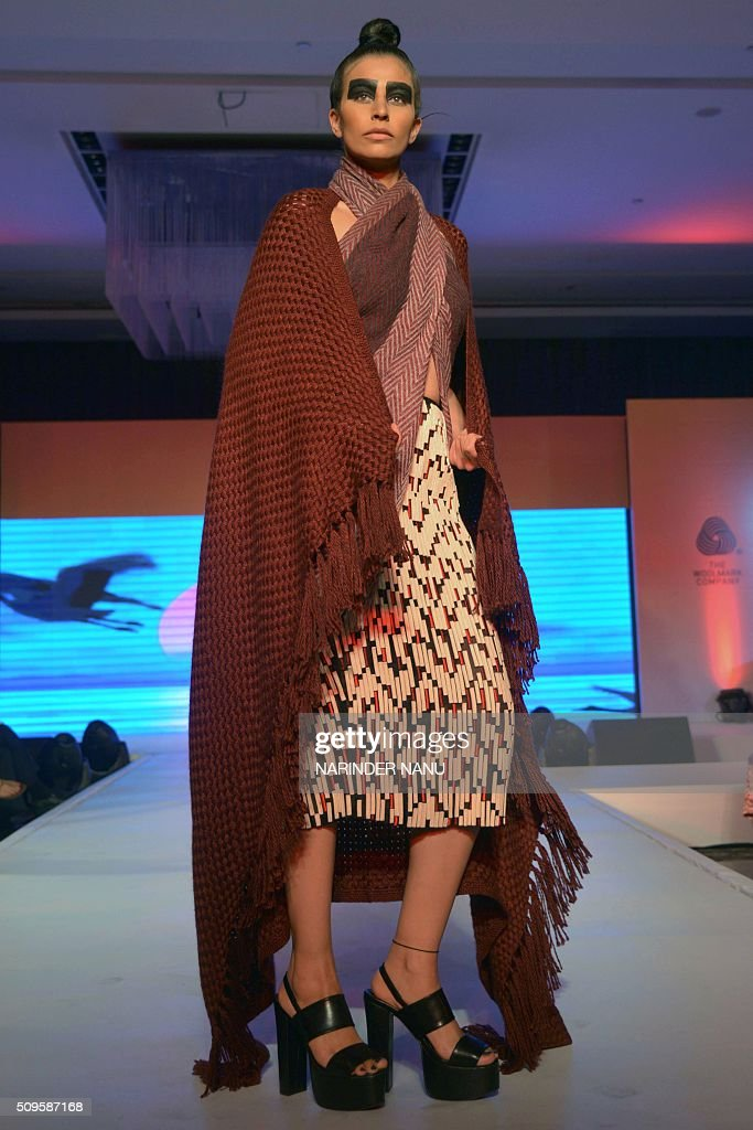 A model presents a creation of Indian fashion designer Nachiket Barve during a fashion show organised by Woolmark at a hotel in Amritsar on February 11, 2016. The seminar was followed by a fashion show displaying an exclusive collection of stylish Australian Merino wool shawls and stoles. The Woolmark company has also convinced its partners to go in for innovative designs as traditional products might not get buyers in this not-so-cold winter. Woolmark has 121 partners, which include manufacturers of shawls, stoles and knitwear spread across Punjab and other north Indian cities. / AFP / NARINDER NANU