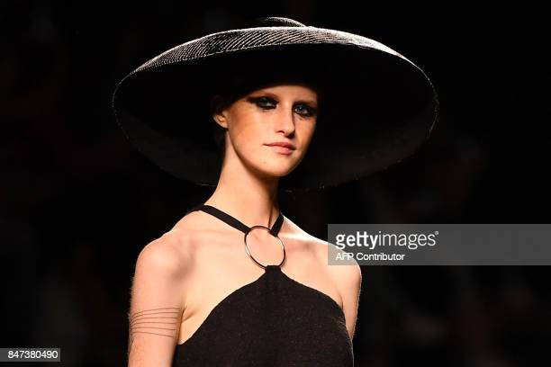 A model presents a creation of Ion Fiz's Spring/Summer 2018 collection during the Madrid Fashion Week in Madrid on September 15 2017 / AFP PHOTO /...